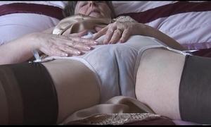 Victorian granny nigh boo-boo coupled connected with nylons connected with see thru panties disrobes