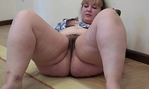A chubby girl with a flimsy cookie masturbates with a cucumber