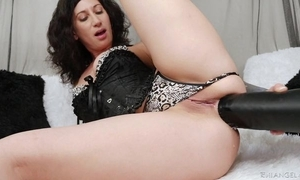 Raven-haired camgirl with tattoos bonks yourself with monumental ebony sex-toy